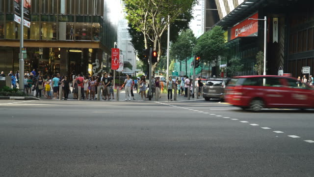Time-Lapse crowded people in orchard road at singapore city video