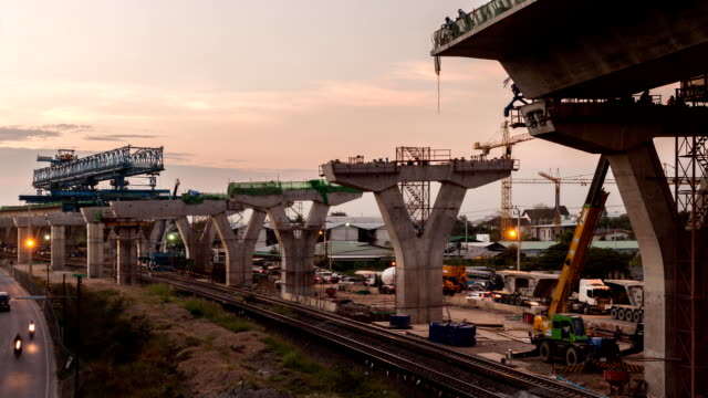 Timelapse day to night at express way construction site with traffic on road video