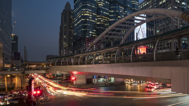 4K Timelapse day to night of Bridge and Intersection Sathorn district at Bangkok Thailand. Business capital center of Bangkok. Pan 4K Timelapse day to night of Bridge and Intersection Sathorn district at Bangkok Thailand. Business capital center of Bangkok. Pan bangkok stock videos & royalty-free footage