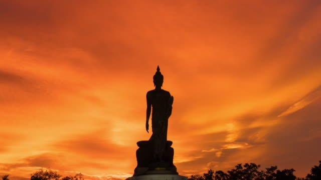 4K Timelapse Day to Night: Silhouette buddha in sunset.