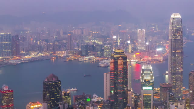 Time-lapse: Day to night sunrise scene of hongkong cityscape view from victoria peak. - vídeo