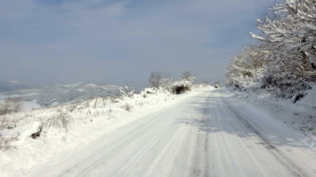 Timelapse driving during Winter conditions. Snow driving hazards and weather concept video