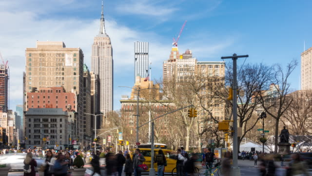 Time-lapse: FlatIron district at Broadway and Fifth avenue in New York City USA looking north