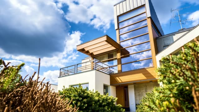 Time-lapse floating clouds above the house Time-lapse floating clouds and views of the apartments modern house stock videos & royalty-free footage