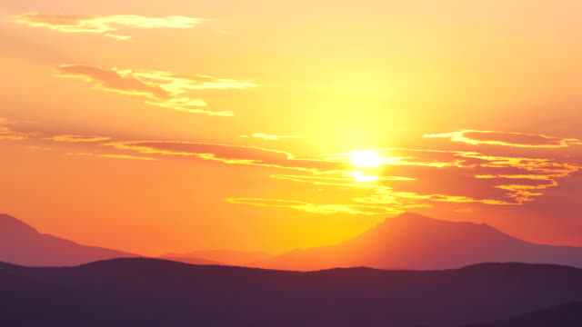 Time-lapse footage of the sun setting behind the mountain in Crimea, Ukraine. Beauties of Nature concept video.
