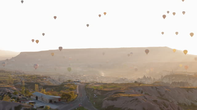 Time-lapse : Hot air balloons in Cappadocia passing over the valley Göreme in Turkey with  the early morning, 4K Resolution.