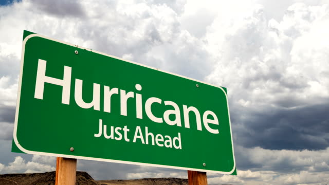 4K Time-lapse Hurricane Just Ahead Green Road Sign and Stormy Cumulus Clouds and Rain. video