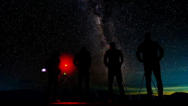 Time-lapse Long short Photographer take photo a Milky way and star trail at night mountian. video