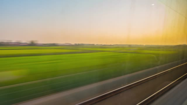 Time-lapse looking out of window from moving train