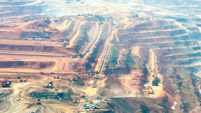 Timelapse Mining dump trucks working in Lignite coalmine lampang thailand video