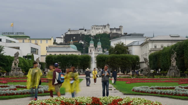 Timelapse Mirabell Gardens with the old historical castle in Salzburg, Austria