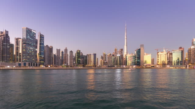 4K Timelapse - Modern city skyline and and cityscape at sunset in Dubai UAE.