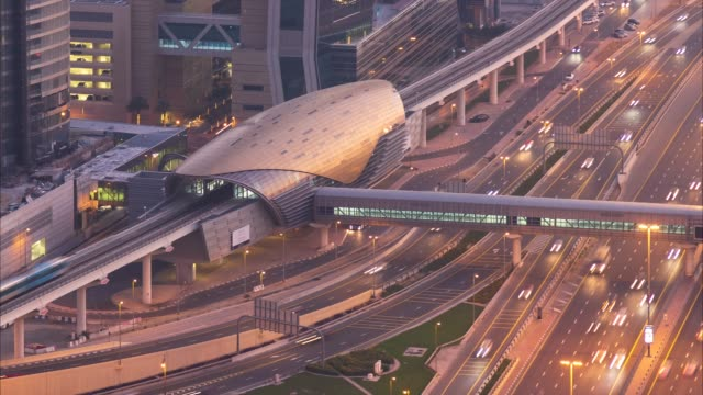 4K Timelapse - Modern driverless Dubai elevated Rail Metro System, running forward alongside the Sheikh Zayed Road