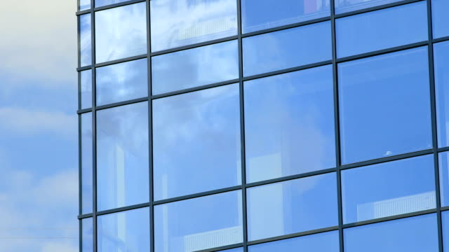 Time-lapse Modern glass building exterior video