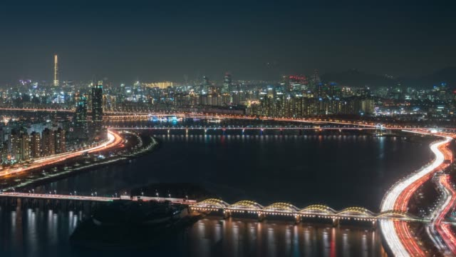 Timelapse night view of bridge cross over Han river from Yeouido business district Timelapse night view of bridge cross over Han river from Yeouido business district at Seoul city, South Korea namsan seoul stock videos & royalty-free footage