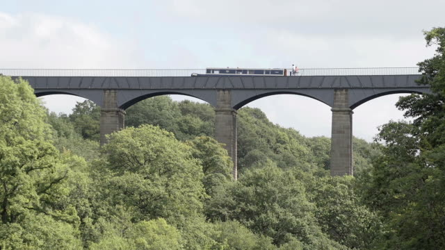 Timelapse Of A Barge Traveling Over The Pontcysyllte Aqueduct A timelaspe shot of a barge travelling over the world famous Pontcysyllte Aqueduct on the Llangollen Canal between Wales and England. aqueduct stock videos & royalty-free footage