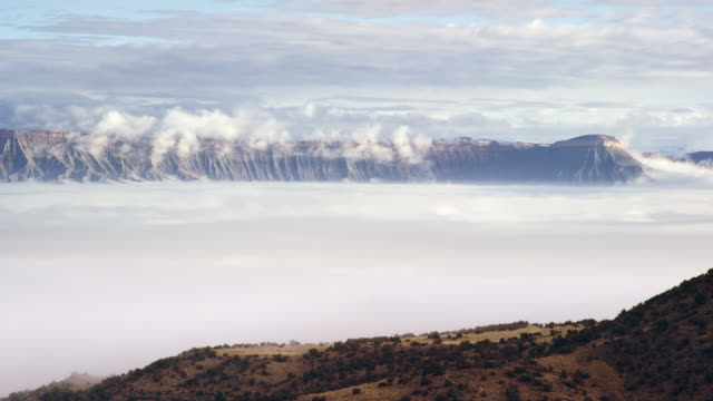 TimeLapse of a Cloud/Fog Inversion Settling over the Grand Valley in Western Colorado with the Bookcliffs and Mount Garfield in the Background