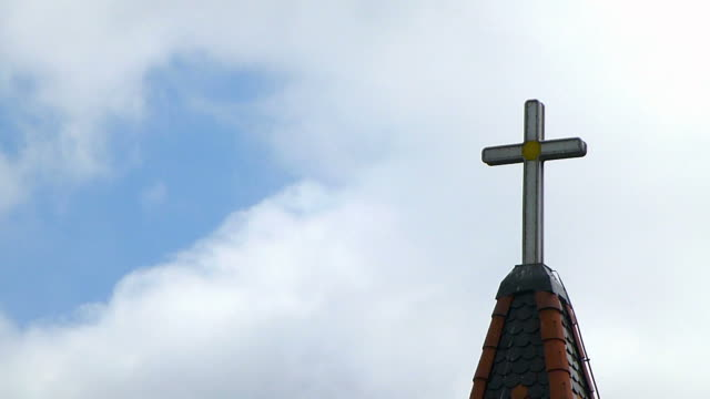 Time-lapse of a cross with the clouds passing by in the background video