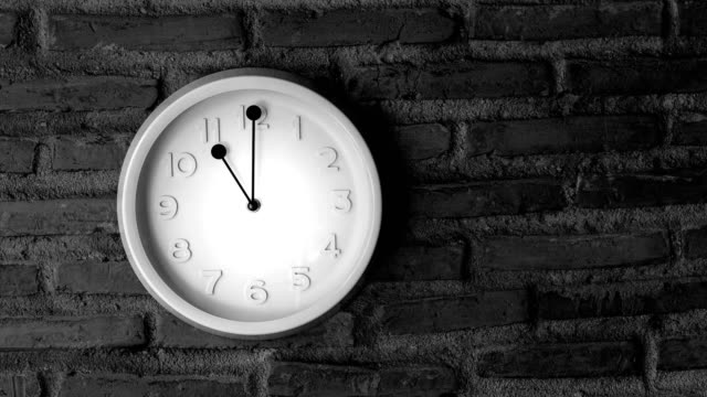 Timelapse of a wall clock with rustic wall in the background. Zooming movement - 4k take. daylight savings stock videos & royalty-free footage