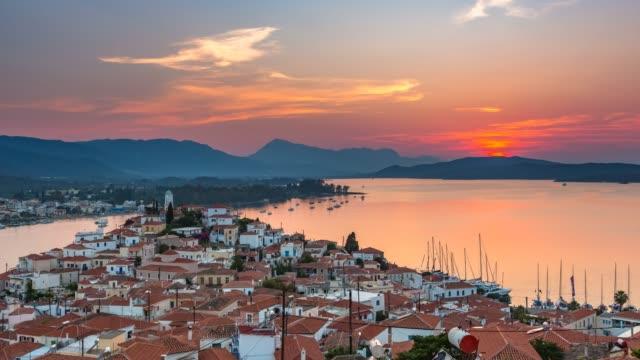 timelapse av flyg foto på poros, grekland vid solnedgången - poros greece bildbanksvideor och videomaterial från bakom kulisserna