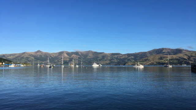 Time-lapse of Akaroa New Zealand, Daly's Wharf at blue sky video