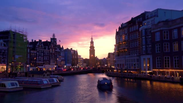 Timelapse of Amsterdam Cityscape and Amstel River with Dramatic Clouds Timelapse of Amsterdam Cityscape, Coin Tower and Amstel River with Dramatic Clouds, Holland, Netherlands amsterdam stock videos & royalty-free footage