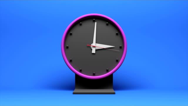 timelapse of an animated clock going through 12 hours - alarm clock bildbanksvideor och videomaterial från bakom kulisserna