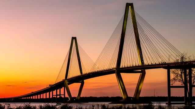 Timelapse of Arthur Ravenel Jr. Bridge in Charleston, SC Timelapse of Arthur Ravenel Jr. Bridge in Charleston, SC at twilight with a ship passing through south carolina stock videos & royalty-free footage