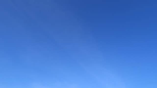 TimeLapse of Beautiful sunny clear blue sky with minimal cirrus or cirrostratus cloud