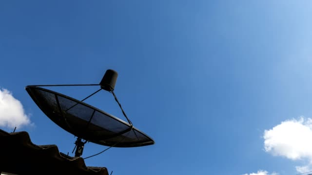 Time-lapse of Black antenna communication Satellite dish with blue sky and cloud background. Time-lapse of Black antenna communication Satellite dish with blue sky and cloud background. telephone receiver stock videos & royalty-free footage