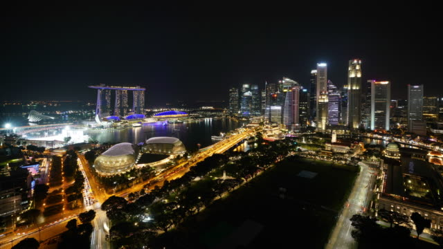 Timelapse of business district of Singapore city downtown at sunset - vídeo