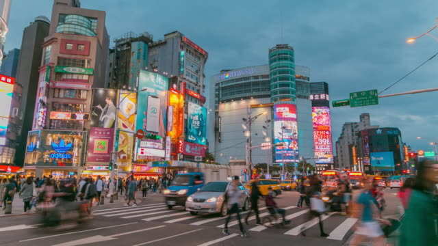 Timelapse of busy crossroad in front of Ximending shopping district in Taipei