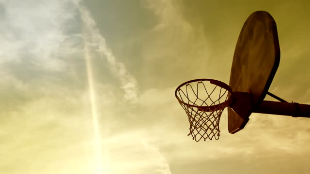 Timelapse of Cinematic Sunset near a basketball hoop in summer video