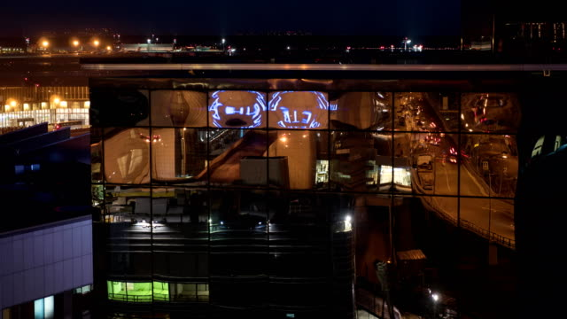 Timelapse of city reflecting in glassy building, night view video