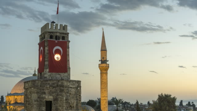 Timelapse of clock tower covered with Turkish flag and minaret Timelapse of clock tower covered with Turkish flag and minaret turkey stock videos & royalty-free footage