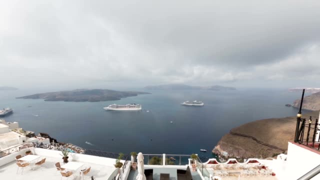 Time-lapse of clouds and movement of ships, the bay of Santorini, Greece Time-lapse of clouds and movement of ships, the bay of Santorini, Greece greek islands stock videos & royalty-free footage