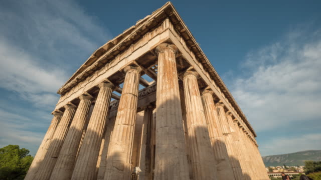 Timelapse of clouds over Hephaestus temple Shadows and clouds moving over Hephaestus temple in Athens architectural column stock videos & royalty-free footage