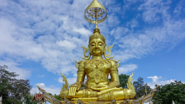 time-lapse of clouds over the golden buddha in day time - hinduizm filmów i materiałów b-roll