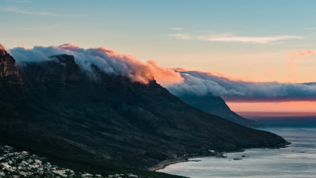 Time-Lapse of Clouds Pouring over Table Top Mountains A time lapse of clouds pouring over the Table Top Mountain in South Africa like a waterfall. Shot in 4K resolution. western cape province stock videos & royalty-free footage
