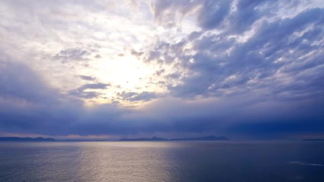 timelapse of clouds rushing over the ocean - pink sunrise bildbanksvideor och videomaterial från bakom kulisserna