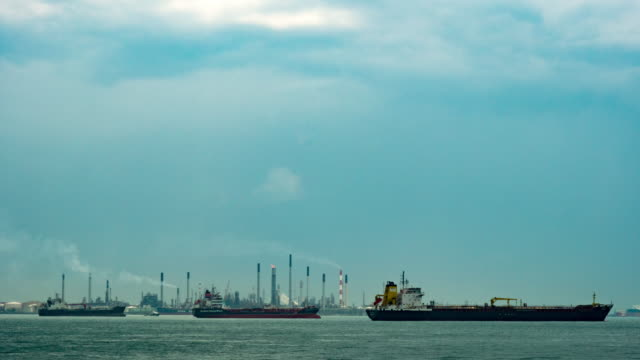 Timelapse of Container ship and oil finery at sea port video