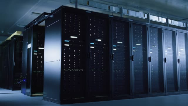 time-lapse of dark data center with light trails flying between multiple rows of operational server racks.concept of fast modern world with instant transfer of information and data flows. - шифрование стоковые видео и кадры b-roll