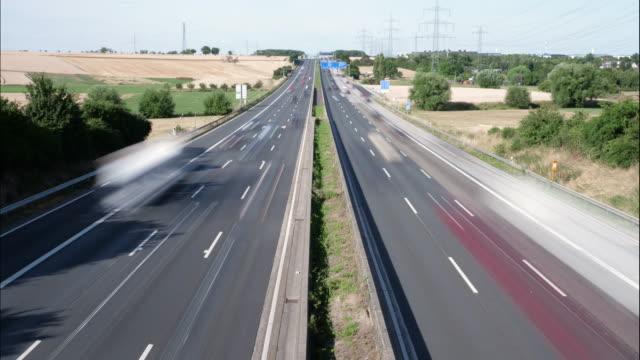 Timelapse of dense traffic on German highway Timelapse of dense traffic on German highway - motion blur autobahn stock videos & royalty-free footage