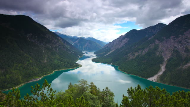 timelapse of dramatic sky and lake plansee, tirol, austria video