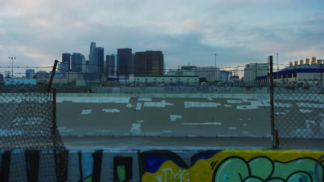 Time-lapse of DTLA skyline and LA River in Los Angeles, California Time-lapse of DTLA skyline and LA River in Los Angeles, California east stock videos & royalty-free footage