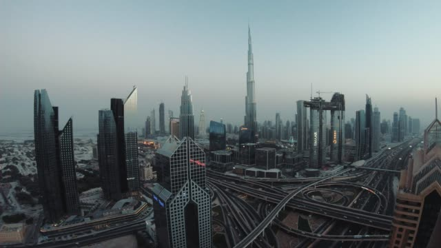 Timelapse of Dubai skyline during sunset blue hour Timelapse of Dubai skyline during sunset blue hour middle east stock videos & royalty-free footage
