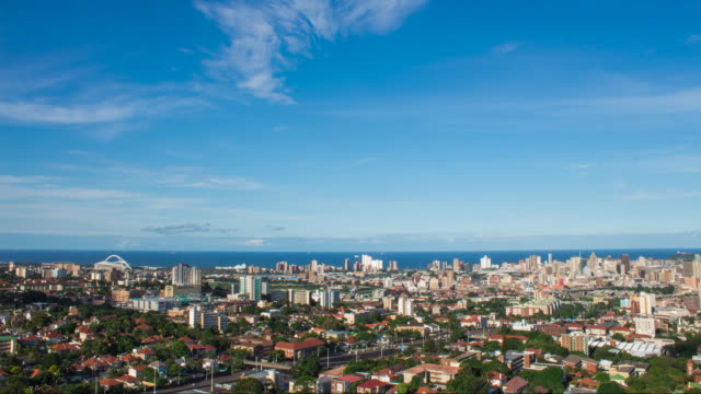 Time-lapse of Durban skyline. Time-lapse of Durban skyline - scenic of houses, city buildings, sea and far horizon. natal stock videos & royalty-free footage
