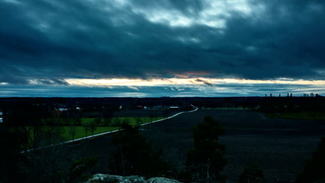 Timelapse of dusk in Sweden Timelapse of dusk in Sweden at late autumn. Beautiful nature and landscape. Nice colorful clouds. Calm and peaceful outdoors video. vinter stock videos & royalty-free footage