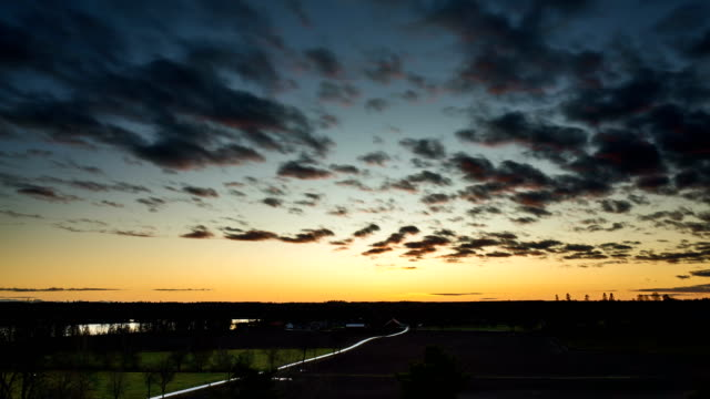 Timelapse of dusk in Sweden Timelapse of dusk in Sweden at late autumn. Beautiful nature and landscape. Nice colorful sky and clouds. Calm and peaceful outdoors video. vinter stock videos & royalty-free footage