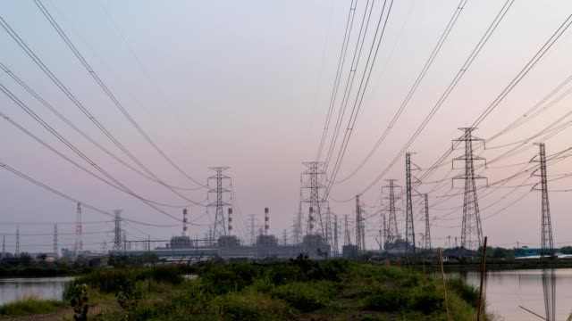 Timelapse of Electric High Voltage Pylon Power Lines at sunset.